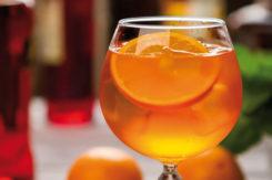 Orange Drink In Wineglass.